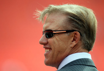 MIAMI GARDENS, FL - OCTOBER 23: General manager John Elway of the Denver Broncos watches his team prior to taking on the Miami Dolphins at Sun Life Stadium on October 23, 2011 in Miami Gardens, Florida.  (Photo by Marc Serota/Getty Images)