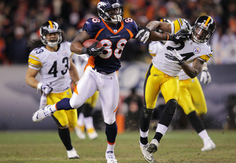 DENVER, CO - JANUARY 08:  Demaryius Thomas #88 of the Denver Broncos stiff arms Ike Taylor #24 of the Pittsburgh Steelers to score an 80 yard touchdown in overtime during the AFC Wild Card Playoff game at Sports Authority Field at Mile High on January 8,