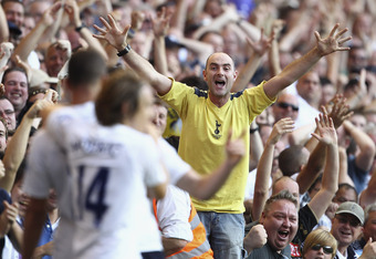 LONDON, ENGLAND - OCTOBER 02:  A Spurs fan celebrates Kyle Walker of Tottenham Hotspur  scoring his side's second goal during the Barclays Premier League match between Tottenham Hotspur and Arsenal at White Hart Lane on October 2, 2011 in London, England.