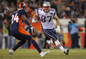 DENVER, CO - DECEMBER 18:  Tight end Rob Gronkowski #87 of the New England Patriots makes a reception as Champ Bailey #24 of the Denver Broncos defends at Sports Authority Field at Mile High on December 18, 2011 in Denver, Colorado. The Patriots defeated