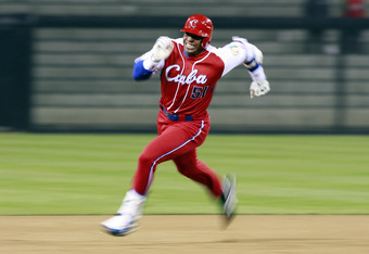 SAN DIEGO - MARCH 18: Yoennis Cespedes #51 of Cuba runs to third base after hitting into the corner of the outfield againts Japan during the 2009 World Baseball Classic Round 2 Pool 1 Game 5 on March 18, 2009 at Petco Park in San Diego, California.  (Phot