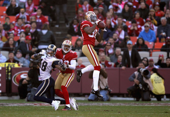 SAN FRANCISCO, CA - DECEMBER 04:  Dashon Goldson #38 of the San Francisco 49ers intercepts a pass intended for Austin Pettis #18 of the St. Louis Rams at Candlestick Park on December 4, 2011 in San Francisco, California.  (Photo by Ezra Shaw/Getty Images)