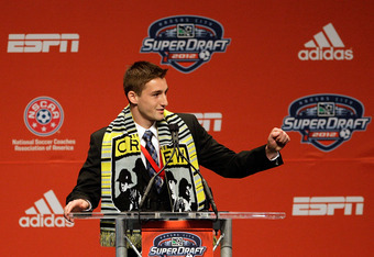 KANSAS CITY, MO - JANUARY 12:  Number 10 overall pick, Ethan Finlay, selected by the Columbus Crew, motions to his family during the first round of the 2012 MLS SuperDraft presented by Adidas on January 12, 2012 at Kansas City Convention Center in Kansas