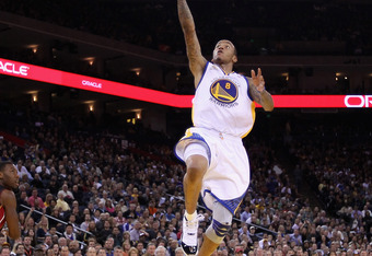 OAKLAND, CA - JANUARY 10:  Monta Ellis #8 of the Golden State Warriors goes up for a shot against the Miami Heat at Oracle Arena on January 10, 2012 in Oakland, California.  NOTE TO USER: User expressly acknowledges and agrees that, by downloading and or