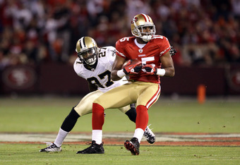 SAN FRANCISCO - SEPTEMBER 20:  Michael Crabtree #15 of the San Francisco 49ers catches a ball while defended by Tracy Porter #27 of the New Orleans Saints at Candlestick Park on September 20, 2010 in San Francisco, California.  (Photo by Ezra Shaw/Getty I