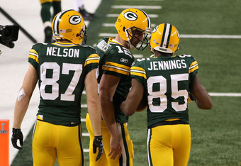 ARLINGTON, TX - FEBRUARY 06: Jordy Nelson #87, Aaron Rodgers #12 and Greg Jennings #85 of the Green Bay Packers celebrate after a 21 yard touchdown against the Pittsburgh Steelers during Super Bowl XLV at Cowboys Stadium on February 6, 2011 in Arlington,