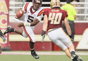 CHESTNUT HILL, MA - SEPTEMBER 25:  Tyrod Taylor #5 of the Virginia Tech Hokies scrambles with the ball as Luke Kuechly #40 of the Boston College Eagles defends on September 25, 2010 at Alumni Stadium in Chestnut Hill, Massachusetts.  (Photo by Elsa/Getty