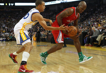 OAKLAND, CA - DECEMBER 25:  Chauncey Billups #1 of the Los Angeles Clippers is defended by Stephen Curry #30 of the Golden State Warriors during the season opener at Oracle Arena on December 25, 2011 in Oakland, California.  NOTE TO USER: User expressly a