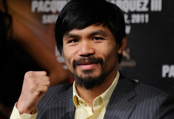LAS VEGAS, NV - NOVEMBER 09:  Boxer Manny Pacquiao poses during the final news conference for his bout with Juan Manuel Marquez at the MGM Grand Hotel/Casino November 9, 2011 in Las Vegas, Nevada. Pacquiao will defend his WBO welterweight title against Ma