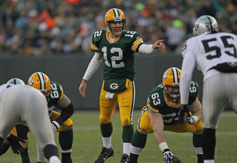 GREEN BAY, WI - DECEMBER 11:  Aaron Rodgers  #12 of the Green Bay Packers calls out a defensive alignment against the Oakland Raiders at Lambeau Field on December 11, 2011 in Green Bay, Wisconsin. The Packers defeated the Raiders 46-16.  (Photo by Jonatha