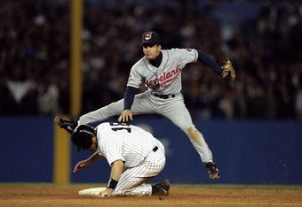 7 Oct 1998:  Infielder Omar Vizquel #13 of the Cleveland Indians in action against infielder Scott Brosius #18 of the New York Yankees during the American League Championship Series game at the Yankee Stadium in the Bronx, New York. The Indians defeated t