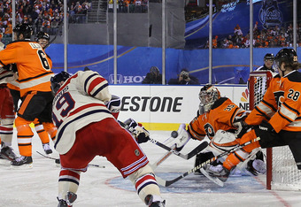 PHILADELPHIA, PA - JANUARY 02:  Brad Richards #19 of the New York Rangers scores a goal in the third period against Sergei Bobrovsky #35 of the Philadelphia Flyers during the 2012 Bridgestone NHL Winter Classic at Citizens Bank Park on January 2, 2012 in