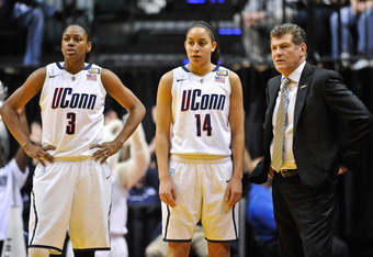 INDIANAPOLIS, IN - APRIL 3:  Tiffany Hayes #3 of the Connecticut Huskies and Bria Hartley #14 of the Connecticut Huskies watch action against the Notre Dame Fighting Irish with Head Coach Geno Auriemma of the Connecticut Huskies during the 2011 NCAA Women