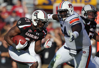 COLUMBIA, SC - OCTOBER 01:  Marcus Lattimore #21 of the South Carolina Gamecocks runs with the ball against Jeffrey Whitaker #54 of the Auburn Tigers during their game at Williams-Brice Stadium on October 1, 2011 in Columbia, South Carolina.  (Photo by St