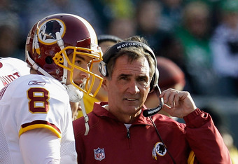 PHILADELPHIA, PA - JANUARY 01:  Rex Grossman #8 of the Washington Redskins talks with head coach Mike Shanahan during the second half against the Philadelphia Eagles at Lincoln Financial Field on January 1, 2012 in Philadelphia, Pennsylvania.  (Photo by R