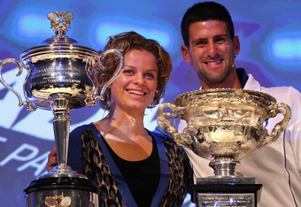 MELBOURNE, AUSTRALIA - JANUARY 13:  Defending champions Kim Clijsters of Belgian and Novak Djokovic of Serbia pose with the Championship trophies at the Official draw ahead of the 2012 Australian Open at Rod Laver Arena on January 13, 2012 in Melbourne, A