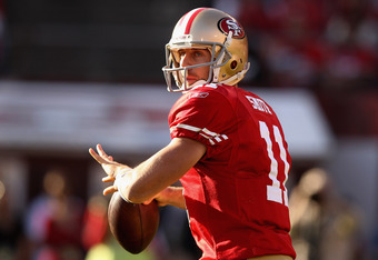 SAN FRANCISCO, CA - JANUARY 14:  Alex Smith #11 of the San Francisco 49ers looks to pass from the pocket during the NFC Divisional playoff game against the New Orleans Saints at Candlestick Park on January 14, 2012 in San Francisco, California.  (Photo by
