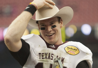 HOUSTON - DECEMBER 31:  Quarterback Ryan Tannehill #17 of Texas A&M Texas A&M Aggies holds his MVP trophy after Texas A&M defeated Northwesten University 33-22 at Reliant Stadium on December 31, 2011 in Houston, Texas.  (Photo by Bob Levey/Getty Images)