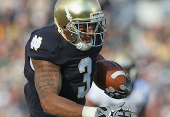 SOUTH BEND, IN - OCTOBER 29: Michael Floyd#3 of the Notre Dame Fighting Irish runs for a touchdown after catching a pass against the Navy Midshipmen at Notre Dame Stadium on October 29, 2011 in South Bend, Indiana. Notre Dame defeated Navy 56-14. (Photo b