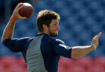 DENVER, CO - AUGUST 20:  Quarterback Tim Tebow #15 of the Denver Broncos warms up before a game against the Buffalo Bills at Sports Authority Field at Mile High on August 20, 2011 in Denver, Colorado. (Photo by Justin Edmonds/Getty Images)