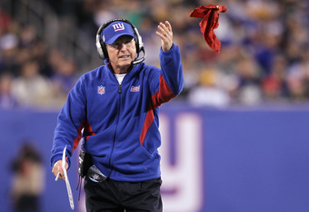 EAST RUTHERFORD, NJ - DECEMBER 04:  Head coach Tom Coughlin of the New York Giants throws the red challenge flag in the first half against the Green Bay Packers at MetLife Stadium on December 4, 2011 in East Rutherford, New Jersey. The Packers own 38-35.