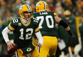 GREEN BAY, WI - JANUARY 15:  Aaron Rodgers #12 of the Green Bay Packers drops back against the New York Giants during their NFC Divisional playoff game at Lambeau Field on January 15, 2012 in Green Bay, Wisconsin.  (Photo by Jonathan Daniel/Getty Images)