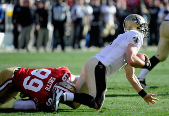SAN FRANCISCO, CA - JANUARY 14:  Aldon Smith #99 of the San Francisco 49ers sacks quarterback Drew Brees #9 of the New Orleans Saints during the first quarter of the NFC Divisional playoff game at Candlestick Park on January 14, 2012 in San Francisco, Cal