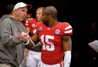 LINCOLN, NE - NOVEMBER 25: Cornerback Alfonzo Dennard #15 of the Nebraska Cornhuskers is greeted by Head Coach Bo Pelini on senior day before playing a  game against the Iowa Hawkeyes at Memorial Stadium November 25, 2011 in Lincoln, Nebraska. Nebraska de