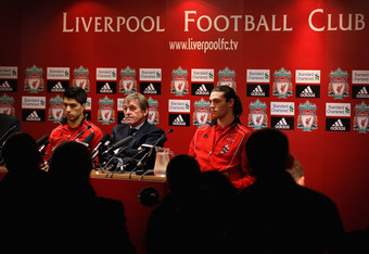 LIVERPOOL, ENGLAND - FEBRUARY 03:  Kenny Dalglish the manager of Liverpool sits between his new signings, Luis Suarez (l) and Andy Carroll (r) as they face the media during a press conference at Anfield on February 3, 2011 in Liverpool, England.  (Photo b