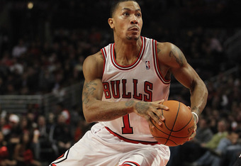 CHICAGO, IL - JANUARY 09:  Derrick Rose #1 of the Chicago Bulls drives the lane against the Detroit Pistons at the United Center on January 9, 2012 in Chicago, Illinois. The Bulls defeated the Pistons 92-68. NOTE TO USER: User expressly acknowledges and a