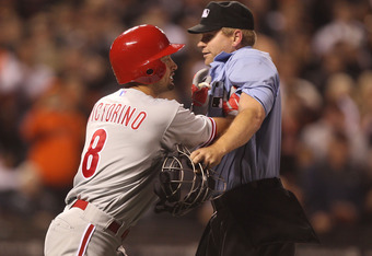 SAN FRANCISCO, CA - AUGUST 05:  Shane Victorino #8 of the Philadelphia Phillies charges the mound as home plate umpire Mike Muchlinski attempts to hold him back against the San Francisco Giants after Victorino was hit by a pitch in the sixth inning at AT&
