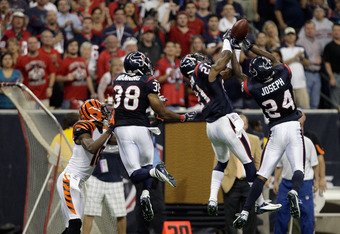 HOUSTON, TX - JANUARY 07:  Johnathan Joseph #24 of the Houston Texans intercepts a pass in the second half against the Cincinnati Bengals during their 2012 AFC Wild Card Playoff game at Reliant Stadium on January 7, 2012 in Houston, Texas.  (Photo by Thom