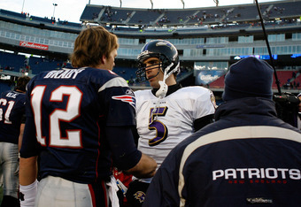 FOXBORO, MA - JANUARY 10:  Quarterback Joe Flacco #5 of the Baltimore Ravens is congratulated on his team's 33-14 win by quarterback Tom Brady #12 0f the New England Patriots during the 2010 AFC wild-card playoff game at Gillette Stadium on January 10, 20