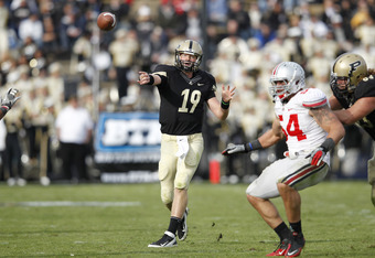 WEST LAFAYETTE, IN - NOVEMBER 12: Caleb TerBush #19 of the Purdue Boilermakers throws a pass against the Ohio State Buckeyes at Ross-Ade Stadium on November 12, 2011 in West Lafayette, Indiana. Purdue defeated Ohio State 26-23 in overtime. (Photo by Joe R
