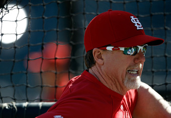ARLINGTON, TX - OCTOBER 21:   Hitting coach Mark McGwire of the St. Louis Cardinals watches the Cardinals work through batting practice ahead of Game Three of the World Series at Rangers Ballpark in Arlington on October 21, 2011 in Arlington, Texas.  (Pho