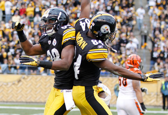 PITTSBURGH, PA - DECEMBER 04:  Emmanuel Sanders #88 of the Pittsburgh Steelers celebrates a fumble recovery with Antonio Brown #84 while playing the Cincinnati Bengals at Heinz Field on December 4, 2011 in Pittsburgh, Pennsylvania.  (Photo by Gregory Sham