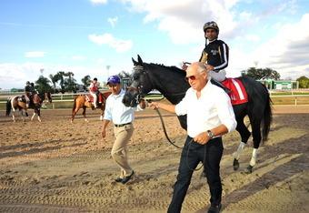 Jimmy Buffett leads Who Dat Ambush into the winner's circle.