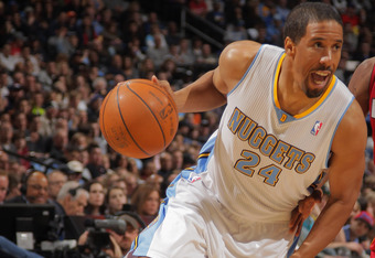 DENVER, CO - JANUARY 13:  Andre Miller #24 of the Denver Nuggets controls the ball against the Miami Heat at the Pepsi Center on January 13, 2012 in Denver, Colorado. The Nuggets defeated the Heat 117-104. NOTE TO USER: User expressly acknowledges and agr