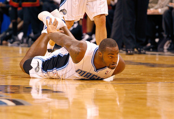 ORLANDO, FL - DECEMBER 21:  Glen Davis #11 of the Orlando Magic slides on the floor after being fouled during a preseason game against the Miami Heat at Amway Center on December 21, 2011 in Orlando, Florida. NOTE TO USER: User expressly acknowledges and a
