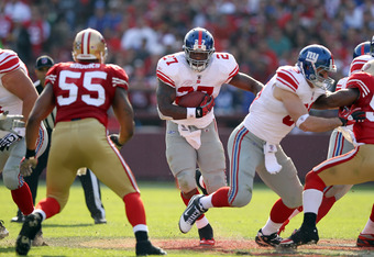 SAN FRANCISCO, CA - NOVEMBER 13:  Brandon Jacobs #27 of the New York Giants runs with the ball San Francisco 49ers at Candlestick Park on November 13, 2011 in San Francisco, California.  (Photo by Ezra Shaw/Getty Images)