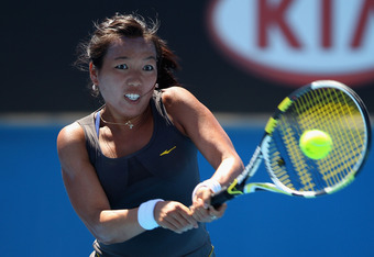 MELBOURNE, AUSTRALIA - JANUARY 19:  Vania King of the United States of America plays a backhand in her second round match against Anastasia Pavlyuchenkova of Russia during day four of the 2012 Australian Open at Melbourne Park on January 19, 2012 in Melbo