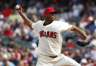 CLEVELAND, OH - SEPTEMBER 25: Fausto Carmona #55 of the Cleveland Indians pitches against the Minnesota Twins during the second inning of their game on September 25, 2011 at Progressive Field in Cleveland, Ohio. The Twins defeated theIndians 6-4. (Photo b