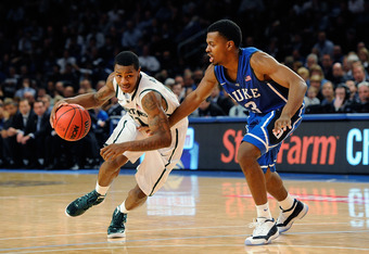 NEW YORK, NY - NOVEMBER 15:  Keith Appling #11 of the Michigan State Spartans drives the ball against Tyler Thornton #3 of the Duke Blue Devils during the 2011 State Farm Champions Classic at Madison Square Garden on November 15, 2011 in New York City.  (