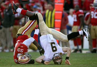 SAN FRANCISCO, CA - JANUARY 14:  Drew Brees #9 of the New Orleans Saints is sacked by Aldon Smith #99 of the San Francisco 49ers in the third quarter of the NFC Divisional playoff game at Candlestick Park on January 14, 2012 in San Francisco, California.