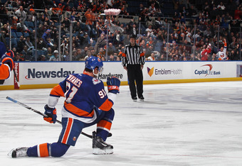 UNIONDALE, NY - OCTOBER 29: John Tavares #91 of the New York Islanders scores a power play goal at 3:15 of the second period against the San Jose Sharks at Nassau Veterans Memorial Coliseum on October 29, 2011 in Uniondale, New York.  (Photo by Bruce Benn