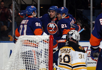 UNIONDALE, NY - MARCH 11: John Tavares #91, Matt Moulson #26 and Kyle Okposo #21 of the New York Islanders celebrate Moulson's goal at 19:58 of the second period against Tim Thomas #30 of the Boston Bruins at the Nassau Coliseum on March 11, 2011 in Union