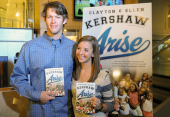 Clayton and wife Ellen signing their new book