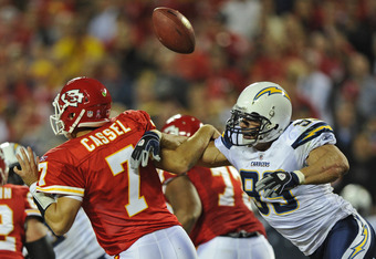KANSAS CITY, MO - OCTOBER 31:  Quarterback Matt Cassell #7 of the Kansas City Chiefs fumbles the ball after getting hit by linebacker Travis LaBoy #99 of the San Diego Chargers during the second quarter on October 31, 2011 at Arrowhead Stadium in Kansas C