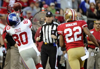 SAN FRANCISCO - NOVEMBER 13:  Victor Cruz #80 of the New York Giants catches this thirty six yard pass over Carlos Rogers #22 of the San Francisco 49ers during an NFL football game at Candlestick Park November 13, 2011 in San Francisco, California. The 49