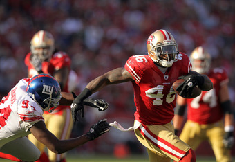 SAN FRANCISCO, CA - NOVEMBER 13:  Delanie Walker #46 of the San Francisco 49ers runs past Mathias Kiwanuka #94 of the New York Giants at Candlestick Park on November 13, 2011 in San Francisco, California.  (Photo by Ezra Shaw/Getty Images)